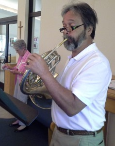 Phil Richardson plays French horn during worship at PEACE.