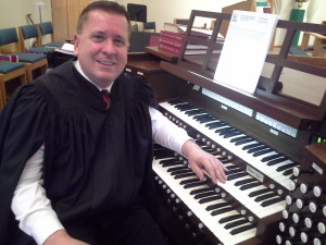 Organist Walt Strony plays during free mini-concerts leading up to Christmas at PEACE Lutheran Church in Grass Valley.