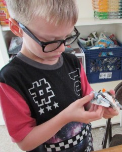 Athan Kerr, 8, loves the challenge of Legos. His life has stabilized, thanks to the Salvation Army's Booth Family Center.