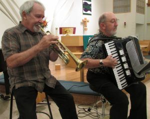 PEACE member Joe Souza, on trumpet, and Dave Fenolio, on accordion, from the Cracker Jack Jazz Band, performed during the Texas Hurricane Fundraising Concert benefitting relief and rebuilding in the Houston area.