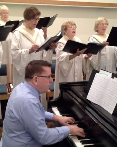 Staff musician Walt Strony plays piano and organ at PEACE Lutheran Church.