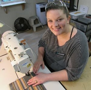 "Kayla Sylva, 28, is training to stitch cushions for high-quality campers built by hand at XP Camper, a Grass Valley manufacturer that exports all over the world. The ""Leap of Faith"" matching fund drive, sponsored by PEACE Lutheran Church, supports the local services that helped Sylva move from chaos to stability."