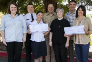 """The Salvation Army's Booth Family Center and Hospitality House recently received checks for $14,139 each from Peace Lutheran Church – the proceeds of the Grass Valley church's """"Leap of Faith"""" fundraising campaign to help area homeless men, women and children. Pictured are, from left, Social Services Director Sarah Eastberg, Lt. Sid Salcido and Lt. Reyna Salcido, of the Salvation Army; congregation President Perry Studt and Pastor Eileen Smith Le Van of PEACE Lutheran Church; and board Vice President Michael McDonald and Development Director Debbie McDonald of Hospitality House."""