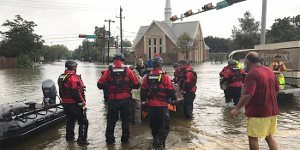 Responders affiliated with Lutheran Disaster Response amid Houston-area floodwaters brought by Hurricane Harvey.